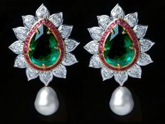 Neety Singh's Pearls  Combining the elegance of pearls with exquisite emeralds, diamonds and precious soft pink stones is Neety Singh's pair of drop earrings