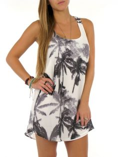 Keep your summer style hot in the lightweight Strange Love Dress. This racerback look features an all over print and a shirttail hem. Has a ...