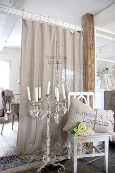 love the long linen drapery & pillow ~ great vintage-chippy candelabra ~ from Love French Bulldogs