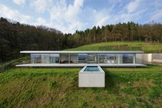 A house of glass, steel and concrete overlooks a rural valley in Germany