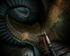 Neat photo of an abandoned staircase.