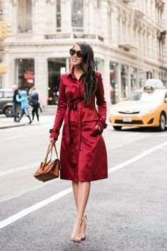 Playing with deep jewel tones, a rich ruby and deep citrine. This red trench is a light and versatile piece, ideal for Spring.