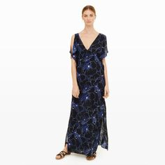 """Relaxed with a drawstring empire waist, the Bridre juxtaposes an ultra-feminine silhouette and accents with a bold floral print. Detailed with split flutter sleeves and high side slits, this elegant maxi is made even more versatile with a longer length that will work with flats <i>and</i> heels. Silk Relaxed fit 58"""" in length from high point of shoulder based on a size M V-neck; V-back; split flutter sleeve detail; drawstring empire waist"""