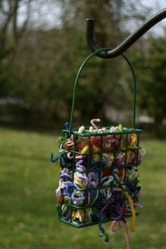 If you're totally done with your scraps, leave them in a bird feeder and watch colorful nests start popping up in nearby trees