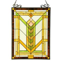 This hand crafted Tiffany style art deco design window panel/suncatcher will brighten up any room. The beautiful white, amber, beige and green color art glass will add color and beauty to any setting. Made by artisans from pieces of hand cut art glass.