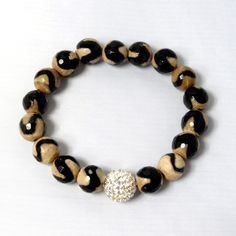Pair this neutral-tone bracelet with an emerald top for a sophisticated look.