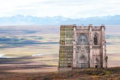 We're such huge fans of German artistMatthias Jung's work that we just had to share his latest work. His has an incredible talentfor combining different photographic elements to create surreal pieces of architecture, set among real life landscapes. Can't you see one of thesescenes as the set
