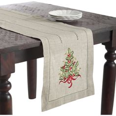 Features:  -Material: Linen.  -Embroidered xmas tree design table runner for a festive holiday table setting.  Color: -Beige; Green.  Pattern: -Holiday.  Holiday Theme: -Yes.  Seasonal Theme: -Yes.  H