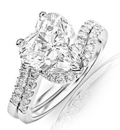1.17 Carat Heart Cut / Shape 14K White Gold Curving Pave & Prong-set Round Diamond Engagement Ring ( H-I Color , SI1 Clarity )