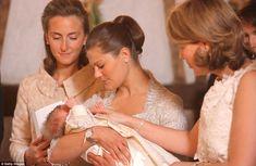 Princess Claire of Belgium, Princess Victoria of Sweden holding Princess Eleonore of Belgium during her baptism at the Chapel of Ciergnon Castle on June 14, 2008 in Ciergnon, Belgium