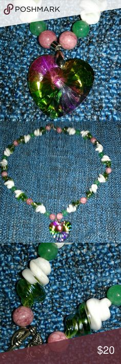Fun and Funky Glass Prism Necklace One of a kind. The glass prism pendant reflects many colors. Twisty green and white beads with fuchsia marbled beads. Measures 12 inches from clasp to bottom of pendant. Has an antique rose toggle clasp. handcrafted by Sue Jewelry Necklaces