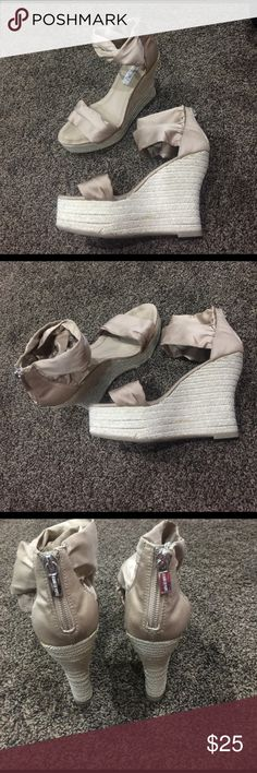 Taupe/Gold/Beige wedges. Size 7. Jennifer Lopez Beautiful satin top and rope wedges. Wore a couple of times. The rope has some glue but not noticeable (see pics) and I bought them like that. Size 7. Super comfortable. Bundle and save! Jennifer Lopez Shoes Wedges