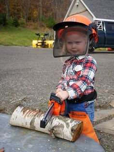 Maine girl with her Husqvarna toy chainsaw. So cute!