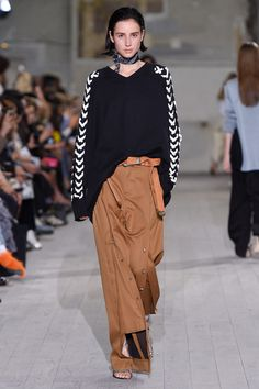 A long belt goes a long way. - The über-long belt has appeared in collections like Vetements and Misbhv. Now, the accessory has made a cameo at Y/Project. There, a braided belt tail lazily hung from the waist of a pair of side-seam-buttoned khakis—a simple styling trick that instantly took the pants out of the office and onto the street.