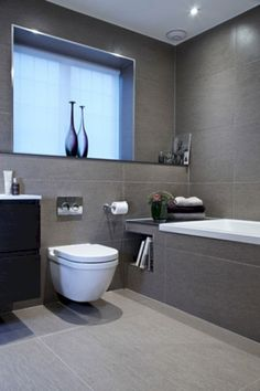 White Bathroom With Charcoal Floor Tiles And Caesarstone Snow