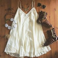"""Sweet White Bohemian Beach Dress, Cotton Blend Get ready for summer with this loose fitting beachy mini dress, boho-hippie style,  soft white, lace neckline and hem,  Cotton blend, super soft feel.  Size Large  (label says XL, but actual size is L)  Measurements: chest 32"""" and stretchy. Waist 48"""". Dress length 25"""". NWOT. Dresses Mini"""