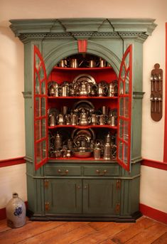 Pewter ~ I hunt down Pewter pieces myself. It lives in what was at sometime way back, a 6 Drawer Dresser.  I do however LOVE this Corner (?) Unit.  The shape of the glass doors must show the lovely patina of the Pewter very well....beautiful Pewter collection and Unit where it lives ~ <3