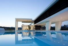 Modern and Luxurious Architecture. The luxurious residence located in Athens, Greece was designed by 314 Architecture Studio. The modern Architecture Design, Beautiful Architecture, Greece Architecture, Building Architecture, Installation Architecture, Ancient Architecture, Future House, Luxury Pools, Bungalows