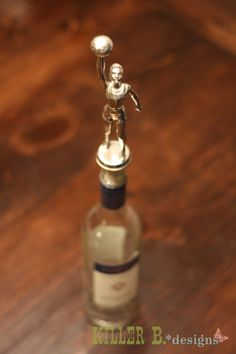 Trophy Wine Stopper - love it!  Wonder if my parents still have my tennis and swimming trophies :)