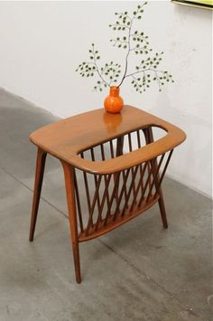 Arthur Umanoff magazine table - Hmmm.... trying to figure out how I could make a knock off.....Wire basket.... #furnituredesign