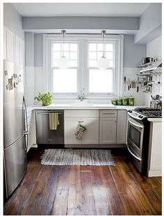 hardwood floors in the kitchen <3 with white cabinets and gray paint