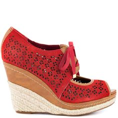 Find your southern hospitality and welcome this beautiful sandal with open arms. The Southern Sunrise by Naughty Monkey showcases a pretty red leather with laser cut details and cute laces. Espadrille partially covers the 4 inch wedge and tan leather trims the 1 inch platform as well.