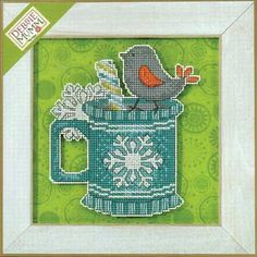 "Peppermint Twist is a fun design in the Winter Cheer collection from Mill Hill.  Stitch a cute coffee mug complete with candy stir stick and bird.  Note:  The model was finished with a background fabric and frame you provide.  Design size is 4.5"" x 5"".  Kit contains 14-count perforated paper, Mill Hill Glass beads, floss, needles and chart with instructions."