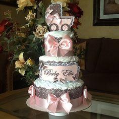 He encontrado este interesante anuncio de Etsy en https://www.etsy.com/es/listing/234448490/baby-girl-diaper-cake-pink-and-brown
