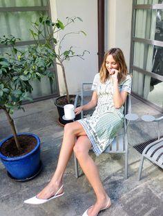 Candela Novembre wearing the Talia dress by Tory Burch in her Milan backyard