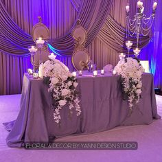 """Purple wedding sweetheart Table "" Check out more sweetheart tables at our head table pic gallery: http://j.mp/yanni-sweetheart"