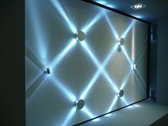 Create interesting patterns on your wall with LED mounted lights...cheaper and easier than wallpaper!