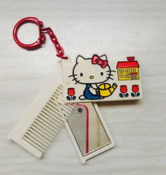 1976 hello kitty comb and mirror keychain
