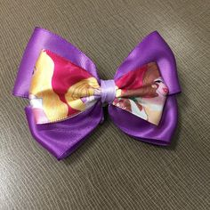 A personal favorite from my Etsy shop https://www.etsy.com/listing/228393854/purple-disney-princesses-themed-hair-bow