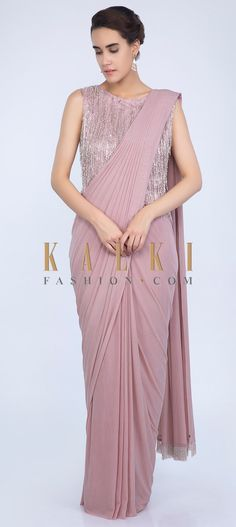Pale pink lycra net ready pleated saree with pre stitched draped pallo. Paired with a heavy embroidered long net blouse . Saree Blouse Neck Designs, Saree Blouse Patterns, Fancy Blouse Designs, Saree Jacket Designs, Look Chic, Saris, Saree Designs Party Wear, Sarees For Girls, Vestidos