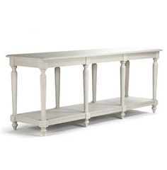 The impressive Alsace buffet console is crafted from solid oak but finished with delicately turned legs and a grey white wash to keep it from looking oppressive. With an open lower shelf running the length of this rustic country buffet, you have storage aplenty. Picture this beauty loaded up with all the fixings of your Thanksgiving feast, with extra china and bright linen napkins stored conveniently below.