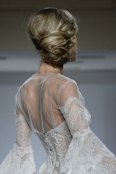 Pin for Later: Game of Thrones-Inspired Braids Are Bridal Week's Dreamiest Trend Pnina Tornai For Kleinfeld Bridal Fall 2015 This dreamy, sideswept chignon is a romantic alternative to the more traditional high and tight bridal updo.