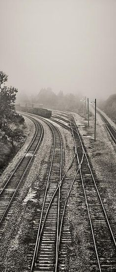 A dense fog creeps into the rail yard at Madisonville, Kentucky, on an early morning, while a few lights in the rail yard remain on in an attempt to keep the yard lighted against the impending fog.