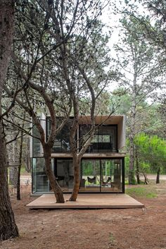 This concrete summer house by Argentinian architect Luciano Kruk stands among pine trees in the seaside resort of Mar Azul near Buenos Aires