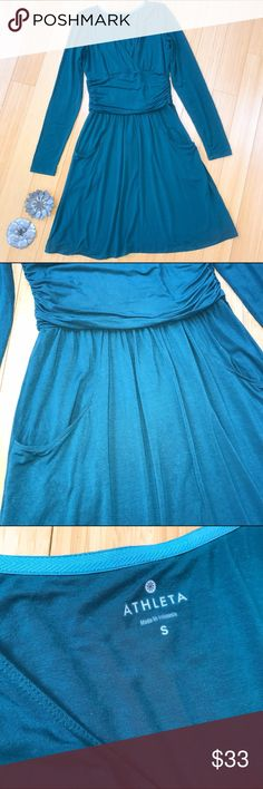 ATHLETA soft teal dress, S. Stunningly soft dress by Athleta, size small. This is a gorgeous jewel tone deep teal color. Faux wrap front with lots of room for the ladies, front pockets, elastic waist. Bust is 18.5 inches, waist stretches to 15 inches, length 40 inches. Really nice condition. So soft you might want to sleep in this. Athleta Dresses Midi