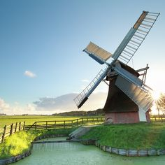 Dutch windmill at summer sunrise by catolla