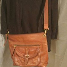 "Leather Fossil handbag Brown leather Fossil bag. The back has one large zippered pocket. The front has a zippered pocket as well as a snap pocket. Inside there is one zippered pocket & two smaller pockets. It measures approx. 11"" height, 14"" length & width is 2.5"". That is measuring the very bottom of bag. I was say it is more like 4 or 5"" wide as far as holding things. Fossil Bags Shoulder Bags"