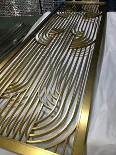 Decorative metal screen, brass finishing.