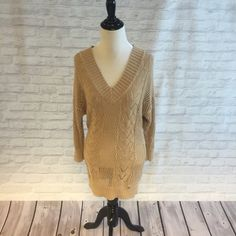 GUESS Long Knit Sweater Beautiful long sweater! Has a deep V neck top. In good condition! Guess Sweaters V-Necks