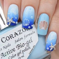 Sea Themed Nail Art Design. Blue color is always associated with the sea. So try on this sea themed nail art design with sea themed accessories to get something out of monotony.