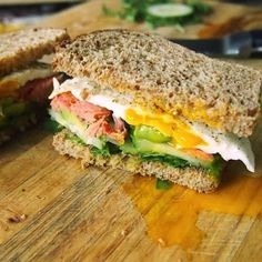 The ultimate breakfast sandwich, piled high with smoked salmon, avocado, a fried egg, cucumber and arugula