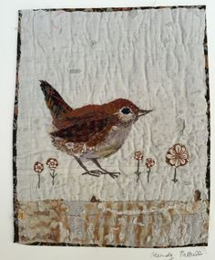 Unframed appliqued wren with embroidery on to vintage quilt fragment