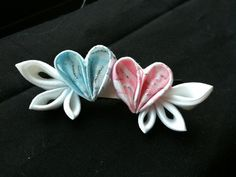 kanzashi flowers pink and blue heart with white wings barrette. $7.00, via Etsy.