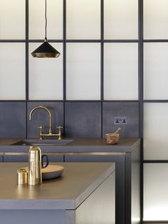 kitchen design brass , tiles, pendatn light, metal cladding Michaelis Boyd Associates — Battersea Power Station Marketing Suite