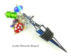 Hey, I found this really awesome Etsy listing at https://www.etsy.com/listing/198106316/wine-bottle-stopper-with-lampwork-beads