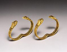 Pair of Bracelets with Lion's-head Terminals Provenance	Iran Period	Persia, Achaemenid period Year	Possibly late 5th to 4th centuries B.C. Materials	Gold Dimensions	H-3.8 W-6.7